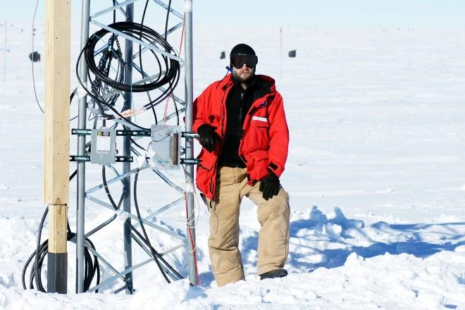 Engineer Rob Young at the South Pole working on a windpower installation